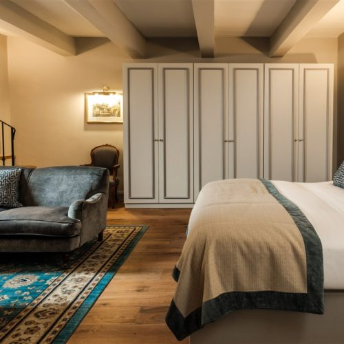 The bedroom of the Deluxe Suite with Terrace and Jacuzzi in the renovated 17th Century Palazzo that is The Xara Palace Relais & Chateaux located within the bastions of the Medieval City of Mdina Malta