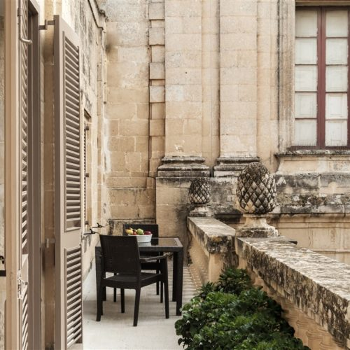 The terrace overlooking the magnificent piazza of The Xara Palace Relais Chateaux in Mdina